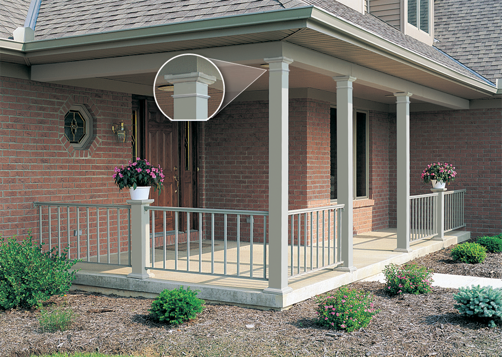 Square smooth aluminum columns on a front porch with decorative astragals