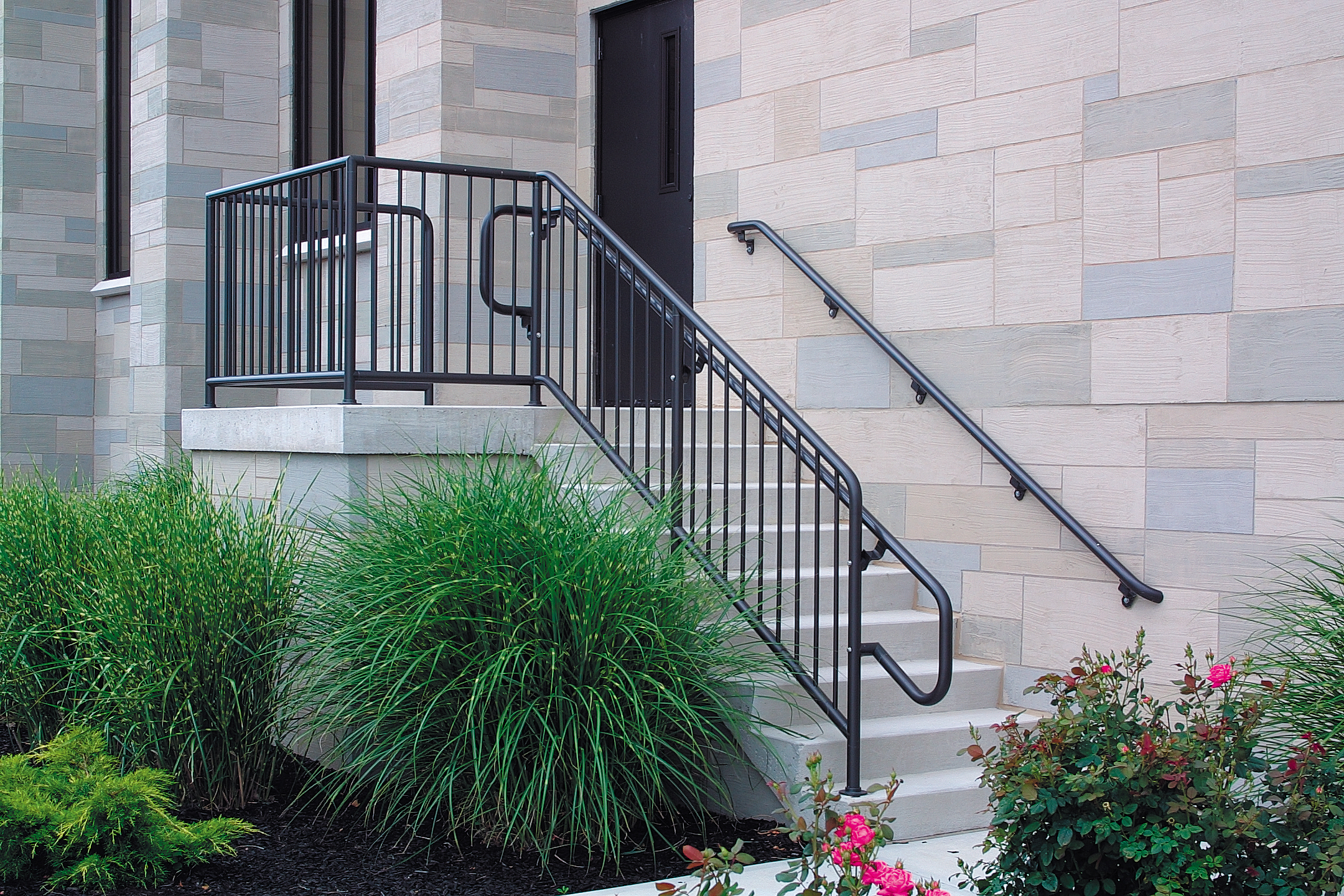 Pipe picket railing situated to assist parishioners travers stairs and enter an Ohio church