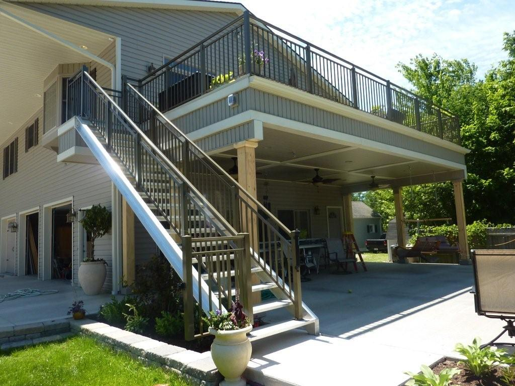 A residential deck is lined with heavy-duty aluminum railing