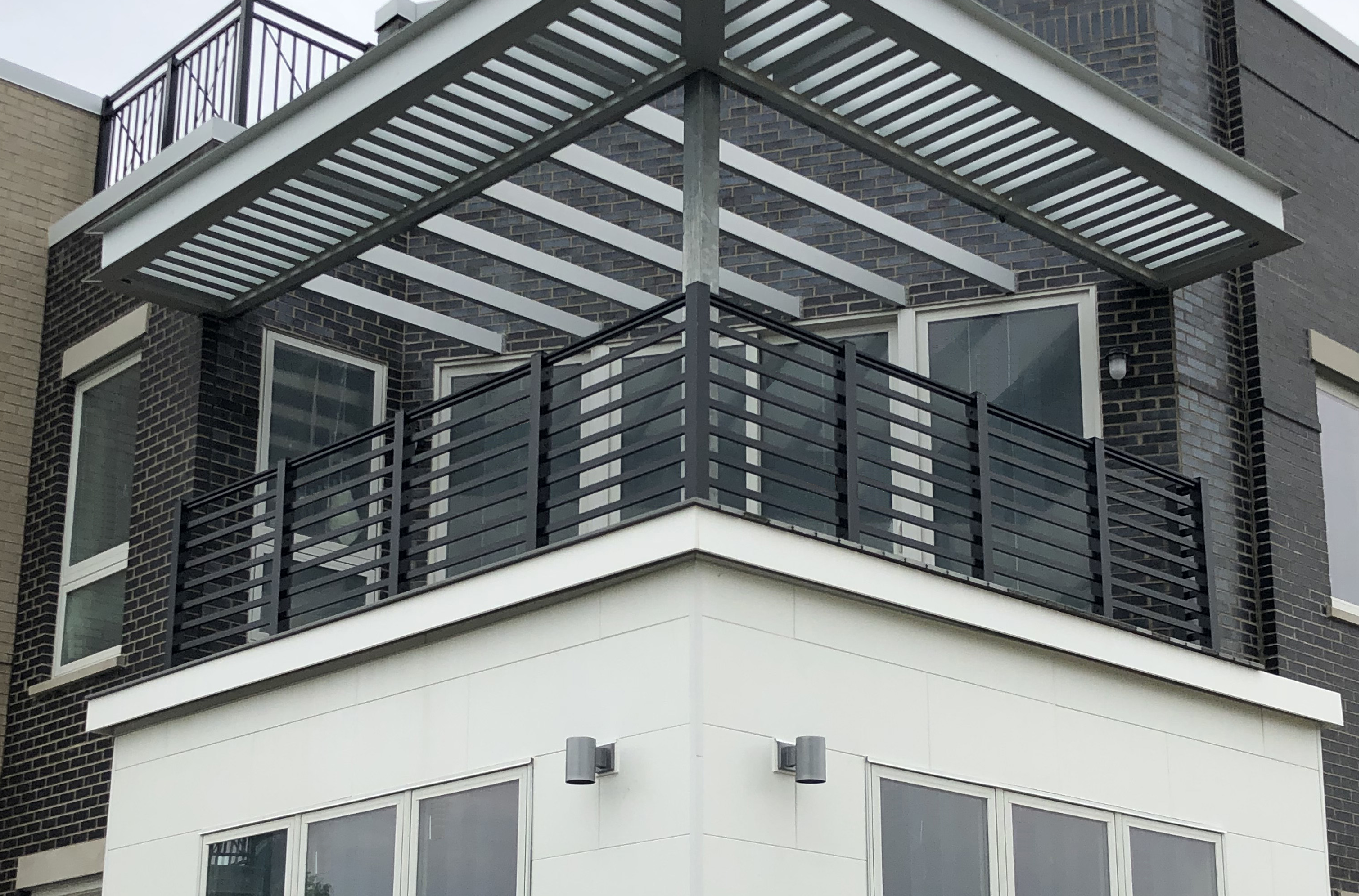 Guardrailing with horizontal lines safeguards an apartment balcony in Dublin, Ohio
